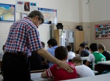 """When not calling the faithful to prayer, Fatih Mosque muezzin Necdet Ergin teaches classes in singing and religion to children. """"I have to pass everything I know to them,"""" he says. Photo by Austin Montgomery"""