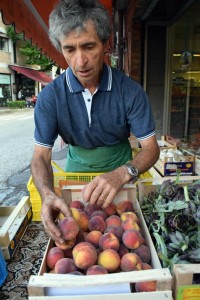 Luigi spends around half an hour unloading and organizing his fruit in the morning.