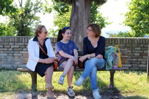 Grandmother, mother and daughter talk amongst themselves in the Fortezza.