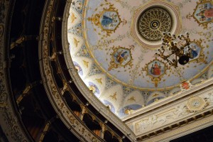 The beautifully detailed ceilings of the Cagli theater, enclosed by a section of the 500 seats that encircle the stage.