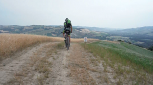 Piergiorgio Guelpa finishes a climb and prepares for the descent into a valley near Castello di Cavallino.