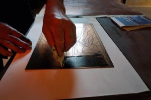 Marcello Tiboni demonstrates his lithography techniques at an exhibit in Urbino, Italy.